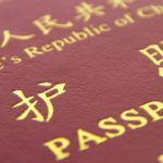 close up of Chinese passport isolated on the white background ** Note: Shallow depth of field